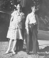 Eva and Edwin Penrose on street where they lived in Salt Lake City, Utah